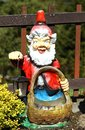 Red gnome painted as a decoration in the garden Stock Photo