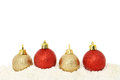Red and gold baubles on snow christmas with white copy space above Stock Images