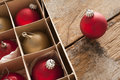 Red and gold Christmas baubles in a box Royalty Free Stock Photo