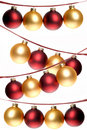 Red and gold Christmas ornaments strung in rows, on plaid ribbon Royalty Free Stock Photo