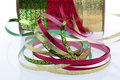 Red gold and green ribbon on spool Royalty Free Stock Image