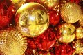 Red and gold shiny Christmas toys balls on the tree Royalty Free Stock Photo