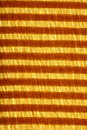 Red and gold striped fabric Stock Photography