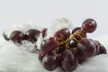 Red grapes in snow white background fresh hand made idea from cotton wool Royalty Free Stock Image