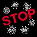 Red graphic inscription – Stop on black background with molecules covid-19. Symbol of protection against coronavirus 2019-ncov.