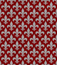 Red and gray fleur de lis textured fabric background that is seamless repeats Royalty Free Stock Photography