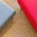 Red and gray seats on carpet floor