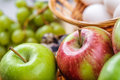 Red and green apple in basket close up Stock Image