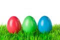Red green blue easter eggs three colored on a meadow isolated on white Royalty Free Stock Photography