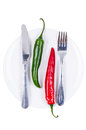 Red and green chili peppers on plate Royalty Free Stock Photography