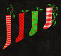 Red and green christmas stockings whimsical illustration of colorful holly Stock Image