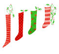 Red and green christmas stockings whimsical illustration of colorful holly Stock Photos