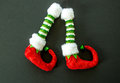 Red and green elf boots isolated on gray Royalty Free Stock Photo