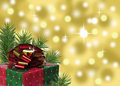 red green and gold Christmas present with abstract background Royalty Free Stock Photo