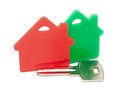 Red with green houses and key on a white background Royalty Free Stock Photography