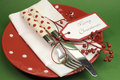 Red and green merry christmas dinner table place setting traditional or lunch Royalty Free Stock Photo
