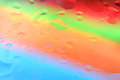 Red green orange and blue water drop background. Royalty Free Stock Photo