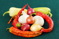 Red and green peppers and onions. Royalty Free Stock Photo