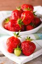 Red and green strawberries on towel in front of bowl Royalty Free Stock Photo