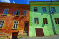 Red and green wall with windows house building in Sighisoara Royalty Free Stock Photo