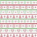 Red and green on the white background Nordic Christmas pattern with snowflakes and forest xmas trees decorative ornaments in scand Royalty Free Stock Photo