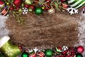 Red, green and white Christmas ornament double border on wood Royalty Free Stock Photo