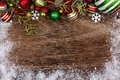 Red, green and white Christmas ornament top border on wood Royalty Free Stock Photo