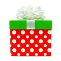 Red, green and white striped Christmas gift box over white