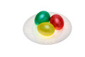 Red green yellow easter eggs plate isolated against white background Royalty Free Stock Photos