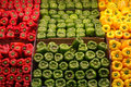 Red green and yellow peppers three rows of Royalty Free Stock Photo