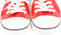 Red gym shoes noses of trendy closeup on white background Stock Image