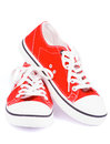 Red gym shoes pair of trendy on white background Stock Images