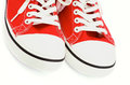 Red gym shoes two trendy closeup on white background Stock Photos