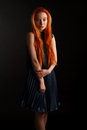 Red hair against dark background beautiful model with fantastic Stock Images