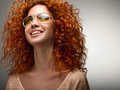 Red Hair. Beautiful Woman with Curly Long Hair and Sunglases Royalty Free Stock Photo