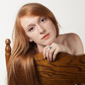 Red hair brown chair an image of a pretty young leaning against the back of a Royalty Free Stock Photography