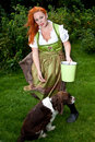 Red hair girl in pin up style bavarian style outdoor with a german dress Royalty Free Stock Photo