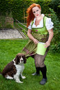 Red hair girl in pin up style bavarian style outdoor with a german dress Stock Images