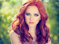 Red hair girl summer portrait of a beautiful with long curly Royalty Free Stock Photography