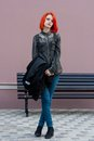 Red Hair Girl walks in square Royalty Free Stock Photo