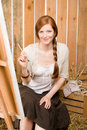 Red-hair romantic woman in barn painting country Stock Photos