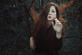 Red hair woman in desolate forest Royalty Free Stock Photo
