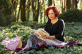 Red hair woman in green forest Stock Photography