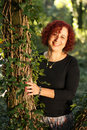 Red hair woman in green forest Royalty Free Stock Photography