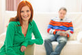 Red hair young woman and boyfriend in background Stock Photos
