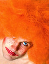 Red haired angry man with a clown make-up Stock Photos