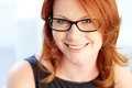 Red haired beauty close up portrait of a with a charming smile Stock Photos