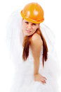 The red-haired bride is in a helmet Stock Photography