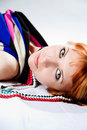 Red-haired coquettish young woman Stock Photo