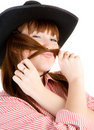 Red haired cowgirl in  hat grimacing Stock Photo
